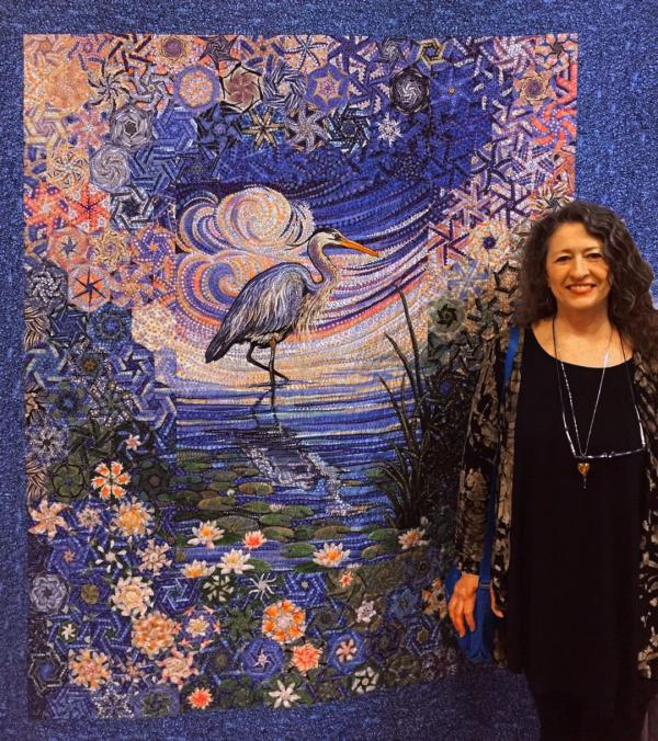 Kathy Kennedy with quilt